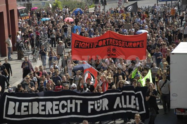 German 1404584776-demonstration-in-berlin-in-solidarity-with-the-refugees_5179567