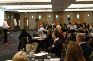 Chair Neil Shah delivers his opening address to a packed room of delegates