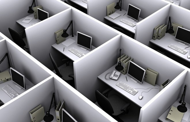 Rows of identical boring cubicles with computers