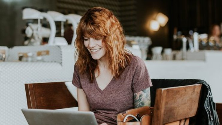 woman applies for a mortgage from laptop to get approved and review offers remotely