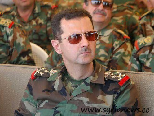 "Syria""s president Bashar Al-Assad in Uniform."