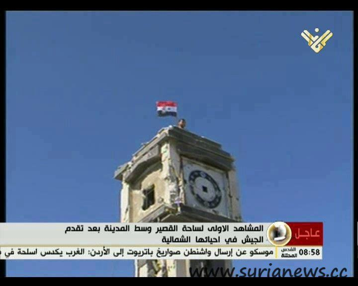 Syrian flag raised high on the center of the city