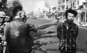"Vietnam: Nguyễn Ngọc Loan, has gunned down (headshot) a suspected Vietcong (""Charlie"")."