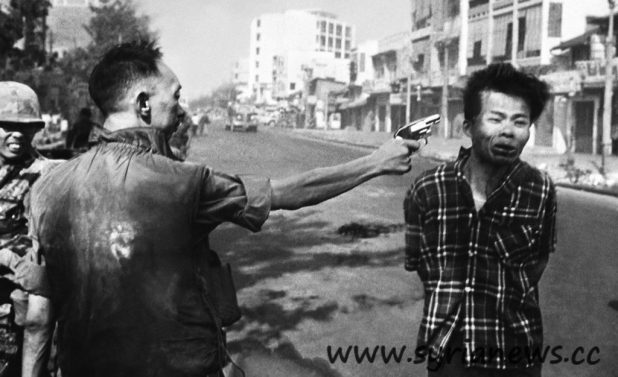 "Vietnam: Nguyễn Ngọc Loan, has gunned down (headshot) a suspected Vietcong (""Charlie"")."