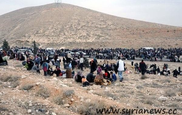 Adra residents being led to saftey by the Syrian Arab Army