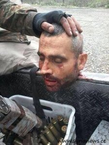 Ahrar al Sham behead syrian soldier after they over run Kasaab