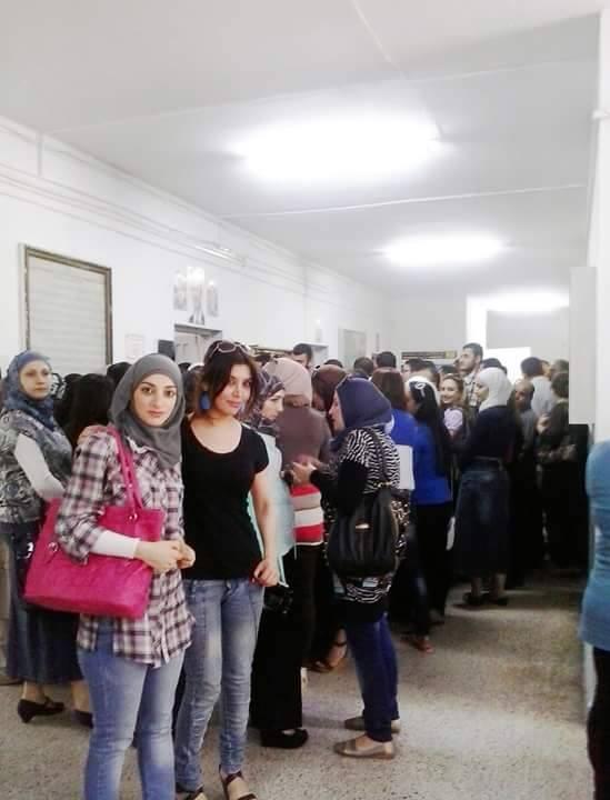 femicide Syrian women voting, 3 June 2014.