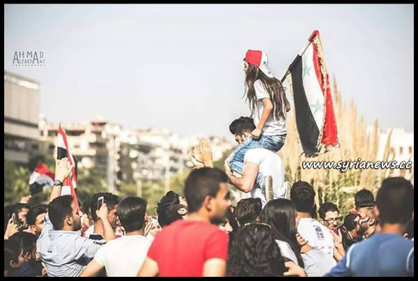 image-syrians-supporting-their-national-team-play-Australia-at-Omayyad-Square-in-Damascus