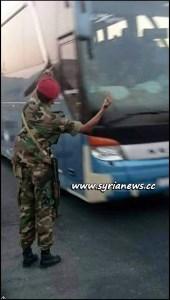image-SAA Soldier Greets Ahrar Cham Terrorists on their way to Idlib
