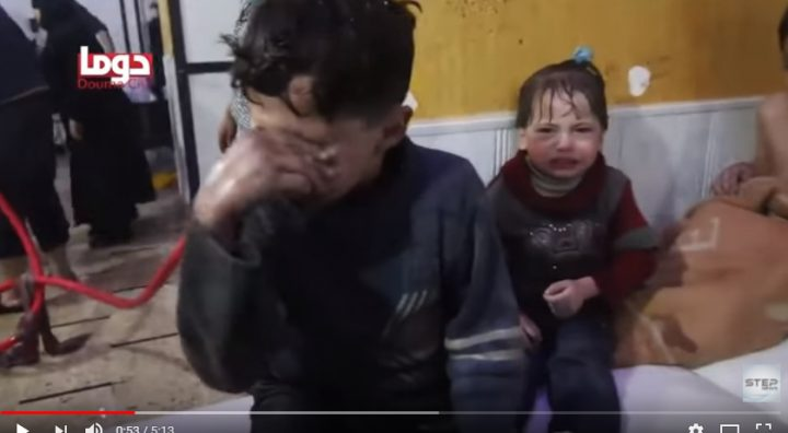 femicide Now soaked boy wipes water from his eyes. Baby on bed is soaked & shivering.
