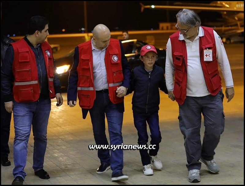 Syrian Red Crescent SRC with Albanian child Alvin heading to Damascus from Hasakah Al Hol going to Italy