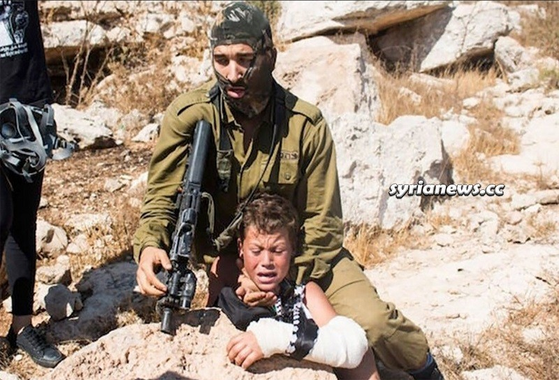 Israel heavily armed IDF beat Palestinian child