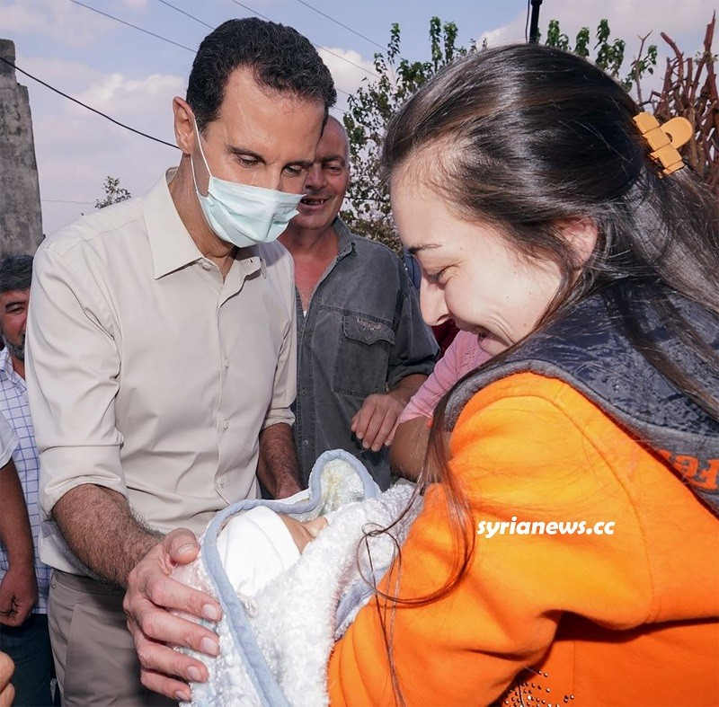 President Assad with the locals in Latakia countryside after the fires