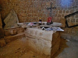 Smashed altar of Sts. Sergius et Bacchus, Ma'aloula. Dating from early 4th century AD, it was unique in its half-circle, rimmed (vs rectangular and flat) design.