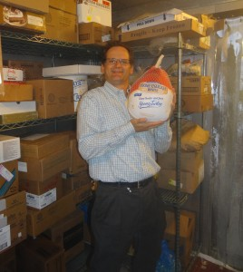Mike Hendrick, Marriott General Manager, places the first turkey donated to PHP for Thanksgiving, 2014 in freezer space donated to PHP by the Santa Ynez Valley Marriott. PHP will need to store up to 300 turkeys prior to November 27th.