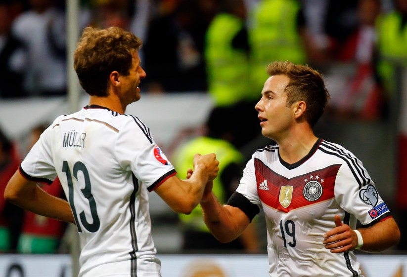 Germany's Mueller celebrates with Goetze during their Euro 2016 qualification match against Poland in Frankfurt