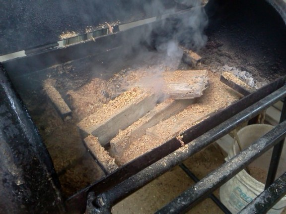 borning wood on barbecue