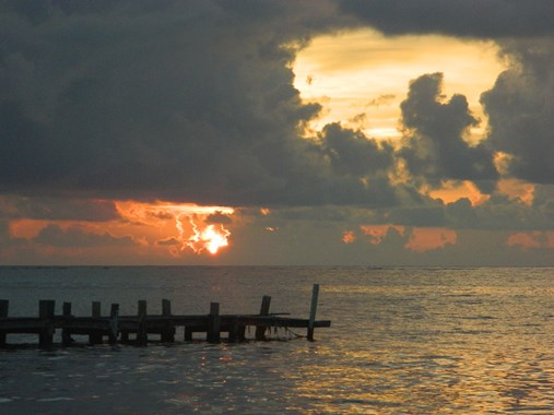 sunrise on the beach  ambergris caye belize