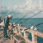 people fishing at pier