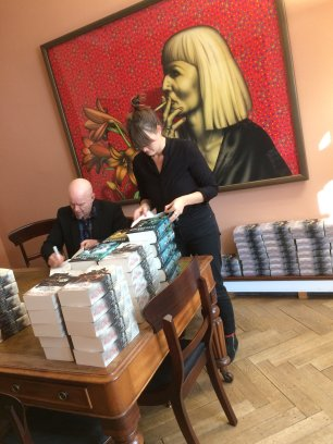 Tad signing books at his publisher´s office