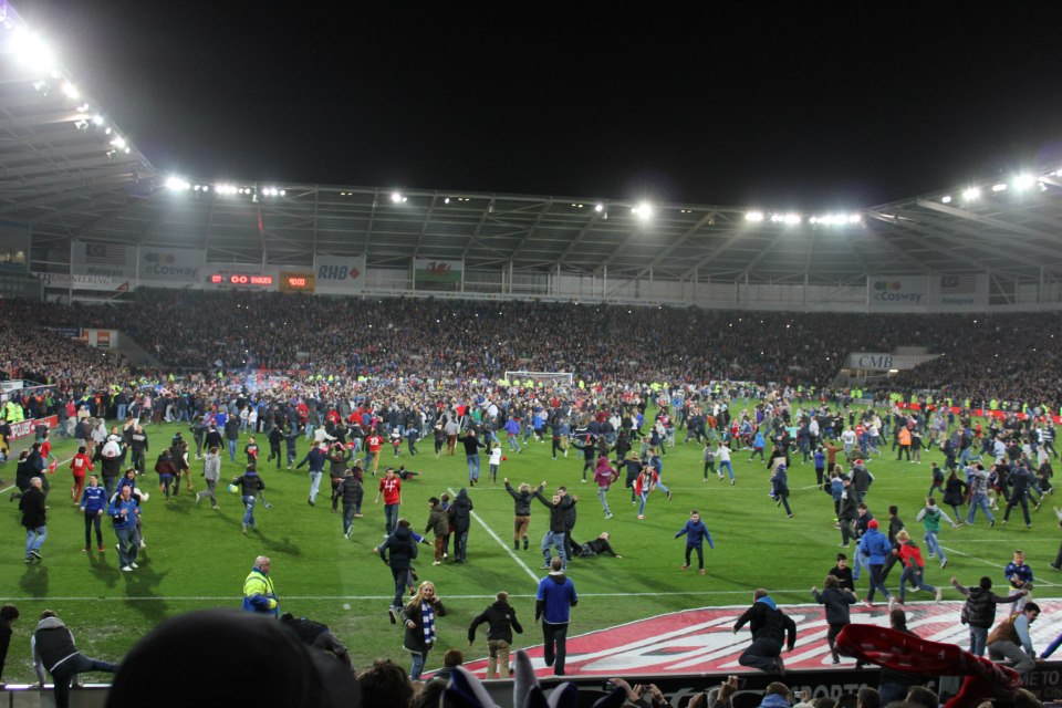Bluebird fans invade the pitch moments after being promoted