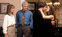 Steve Martin (l.) and Diane Keaton watch their daughter, Kimberly Williams, marry George Newbern in 'Father of the Bride'