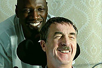 Omar Sy (l.) and Francois Cluzet co-star in 'The Intouchables'