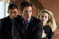 Tom Hardy (l.), Chris Pine, and Reese Witherspoon co-star in 'This Means War'