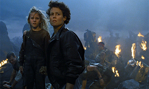 Carrie Henn gets saved by Sigourney Weaver in 'Aliens'