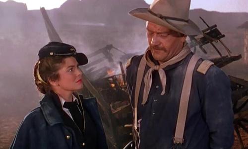 John Wayne with Joanne Dru in 'She Wore a Yellow Ribbon'