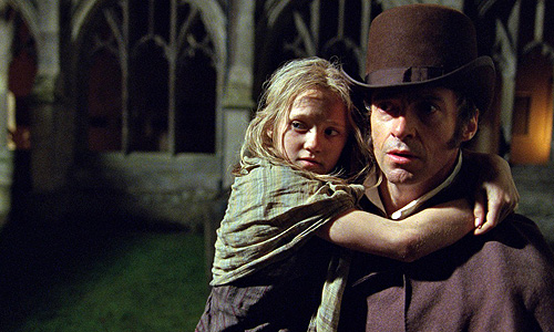 Jean Valjean (Hugh Jackman) finds redemption by raising young Cosette (Isabelle Allen)
