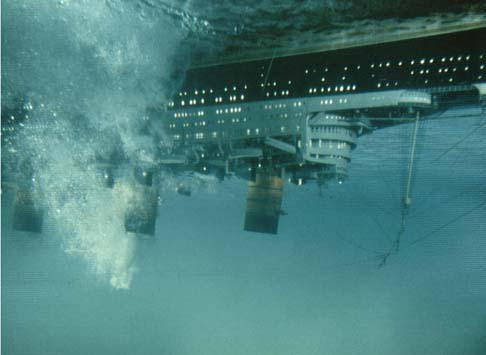 The SS Poseidon lying upside down after being hit by a tsunami