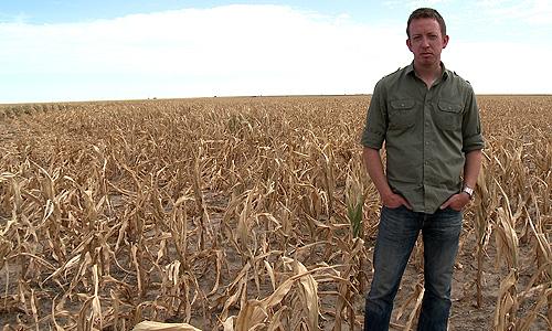 Writer/director Craig Scott Rosebraugh in a field devastated by drought in 'Greedy Lying Bastards'