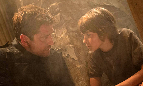 """Mike Banning"" (Gerard Butler) trying to save the President's son (Finley Jacobsen) in 'Olympus Has Fallen'"
