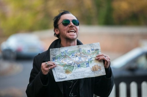 Simon Pegg holding a map of The Golden Mile in 'The World's End'