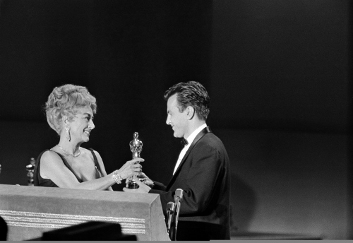 Joan Crawford presenting Maximilian Schell with the Academy Award for Best Actor in a Lead Role in 1962