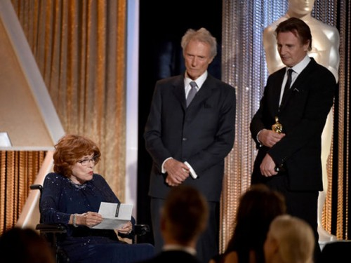 Maureen O'Hara receiving her honorary Oscar at the Governor's Ball from Clint Eastwood and Liam Neeson