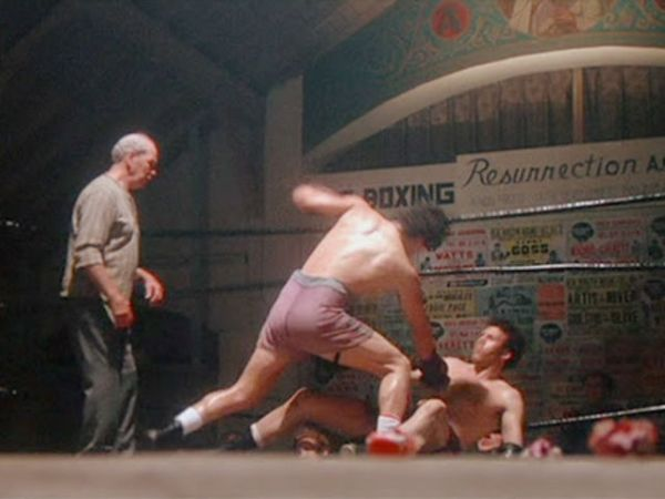 """""""Rocky Balboa"""" knocking out """"Spider Rico"""" in his first movie fight, in 'Rocky'"""