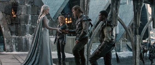 """(L to R) Queen Freya (EMILY BLUNT) with her Huntsmen—Sara (JESSICA CHASTAIN), Eric the Huntsman (CHRIS HEMSWORTH) and Tull (SOPE DIRISU)—in the story that came before Snow White: """"The Huntsman: Winter's War."""" Hemsworth and Oscar® winner Charlize Theron return to their roles from """"Snow White and the Huntsman,"""" joined by Blunt and Chastain."""
