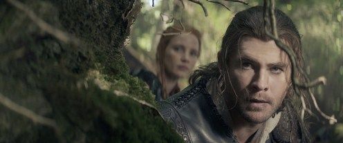 """Eric the Huntsman (CHRIS HEMSWORTH) lies in wait with warrior Sara (JESSICA CHASTAIN) in the story that came before Snow White: """"The Huntsman: Winter's War."""" Hemsworth and Oscar® winner Charlize Theron return to their roles from """"Snow White and the Huntsman,"""" joined by Emily Blunt and Chastain."""
