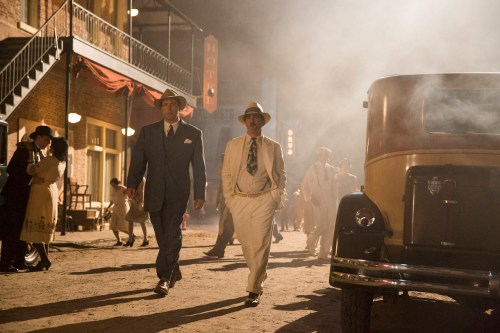 Ben Affleck and Chris Messina walk through Ybor City in 'Live by Night'