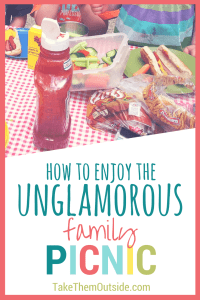 hot dogs, vegetables, and buns on a red checkered table cloth, text reads how to enjoy the unglamorous family picnic