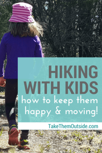 A young girl wearing a purple shirt and pink hat walking in the woods, text reads hiking with kids how to keep them happy and moving