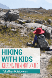 A young girl wearing a red sun hat and a backpack sits on the ground of a rocky path. text reads hiking with kids, keeping them motivated