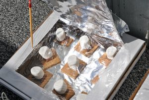 melting marshmallows and chocolate in a homemade solar oven