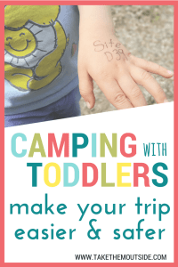 A toddler's hand with a site number written on it, text reads camping with toddlers make your trip easier & safer