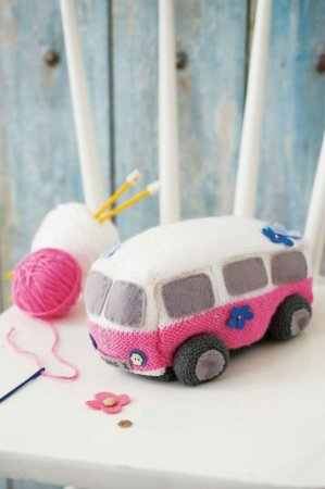 a knitted pink and white camper van plushie