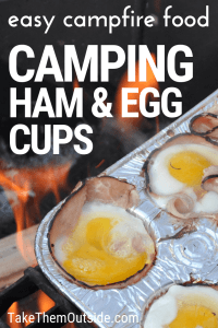 ham and eggs in muffin tins cooking over a campfire