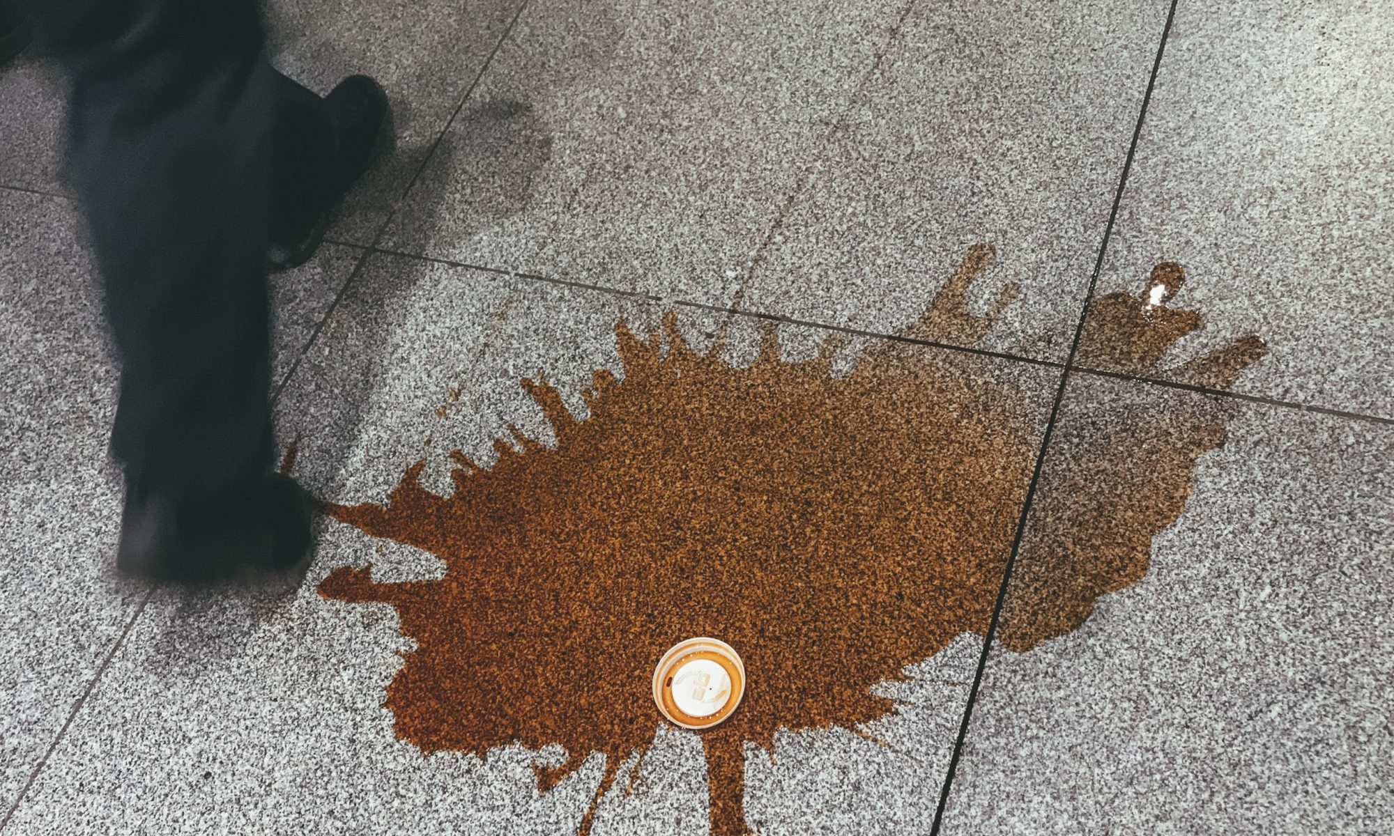 Spilled coffee photo by Kolar.io on Unsplash