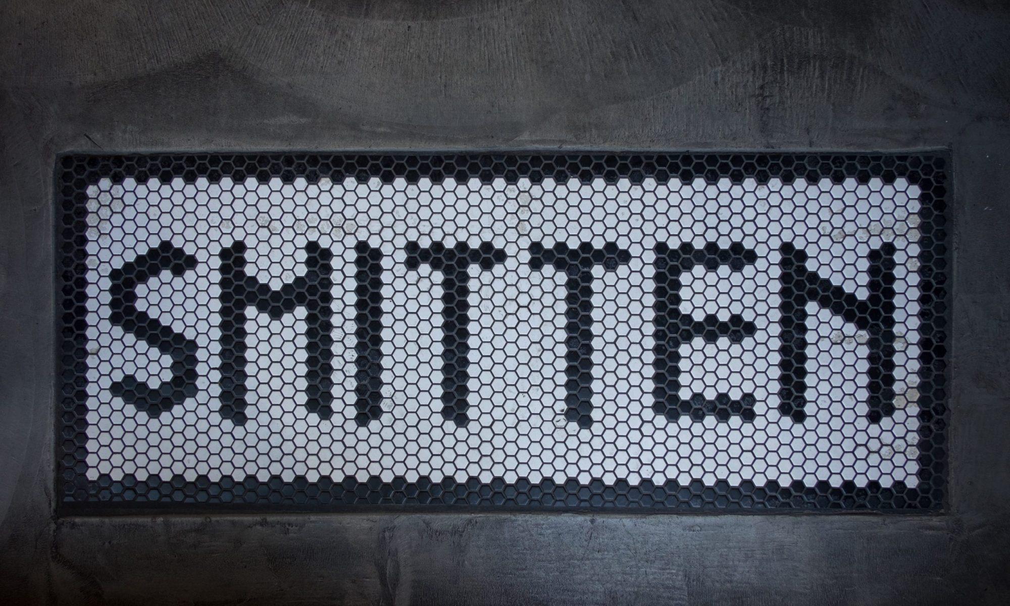 Smitten written in tiles